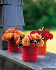 Vases from Chinese paper lanterns and drinking glasses.  Awesome idea.  Would be great for a party.
