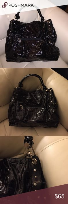 New! Hobo style handbag from CACHE' This bag is awesome with lots of room! It's has a patent leather look w gator print! With stones & stud detail going down the sides & silver hardware! It has a side zipper w lots of room and compartments inside! Never used... time to find this baby a new home🤗 remote was used in the pic to help gage the size! The 1st pic was taken w flash... Cache Bags Shoulder Bags