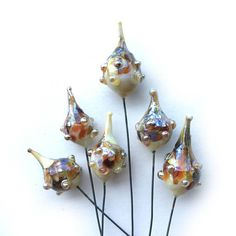 Lampwork Drop Headpins, Funkey Drop Headpins, Organic Lampwork, Decorative Headpins, Set of 6 by Dry Gulch, Summer in the City #545 This lovely lampwork drop headpin set includes 3 pairs of breathtaking handmade medium sized drops. We call this pod-inspired shape Funkey Drops and they have gorgeous colors that have been either mottled or swirled for extra funkey fabulousness! These drops are made with molten glass rods in a high temperature flame, we paint using glass. These pins are…
