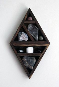 Previous pinner: crystal and mineral stone collection in handmade geometric diamond wood curio shelf
