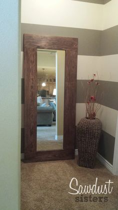 DIY Mirror Frame. Frame a salvaged mirror using wood glue and a staple gun! This is such an easy project. Step by Step tutorial with links for supplies.