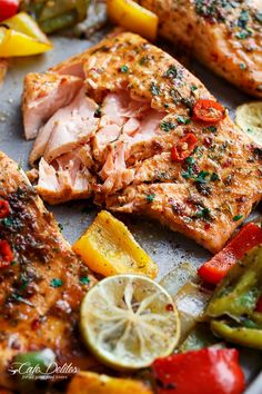 Sheet Pan Chili Lime Salmon | INGREDIENTS ½ cup freshly squeezed lime juice ¼ fresh chopped parsley 2 tablespoons olive oil 2 tablespoons water 1 tablespoon minced garlic 1½ teaspoons red chilli flakes 1 teaspoon ground Cumin 1½ teaspoons salt 1 tablespoon honey 4 salmon fillets 1 red bell pepper 1 green bell pepper 1 yellow bell pepper 1 onion, cut into wedges
