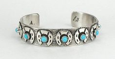 Authentic Native American Sterling Silver and Turquoise Horseshoe bracelet by Navajo Hemerson Brown