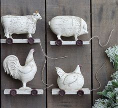 These vintage style farm animals on wheels from Antique Farmhouse would be the perfect addition to my son's farmhouse nursery! #affiliate