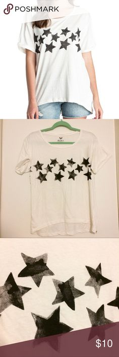 White Roxy cool rocker black star Tee This awesome rock city is perfect for any rock concert this summer! Super soft and loose for that laid/back vibe. Featuring stars on the front with a hand-painted look.  Never been worn! Great condition with the exception of a tiny hole by the back neckline (pictured). Size XS but runs big. Roxy Tops Tees - Short Sleeve