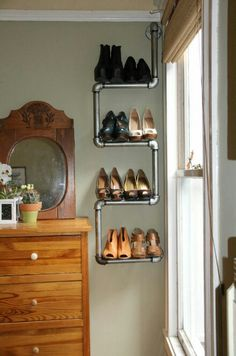 20 Creative Shoe Storage Ideas For Small Spaces. Pipe as creative shoe rack This creative DIY pipe rack does not only hold your shoes but also adds a touch of industrial modern charm to any apartment. Shoe Storage Design, Diy Shoe Storage, Diy Shoe Rack, Creative Storage, Storage Ideas, Shoe Racks, Storage Solutions, Shelving Design, Rack Design