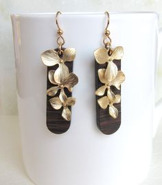 Great Holiday Item + Matte Gold Orchids Over Long Wood Drop Earrings, Wood Earrings, Orchid Dangle Earrings, Ebony Wenge  Earrings, Gold Orchid Earrings by giveitengraved on Etsy