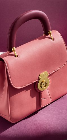 A new collection of Burberry colours in full bloom. Shop The DK88 bag in blossom pink.