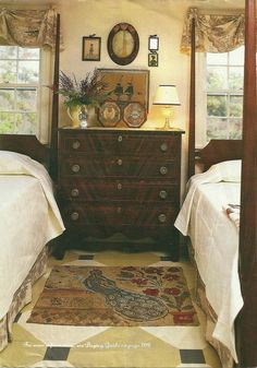 Beautiful A very English affair….I like all of it as would any guest.   So comfy and homey and I love that the chest is used as the side table for both beds.  A wonderful table top arrangement, a  ..