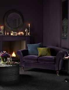 Bold use of such a deep colour, the use of the olive and teal cushions help break it up. Can imagine curling up next to the fire with a good book.