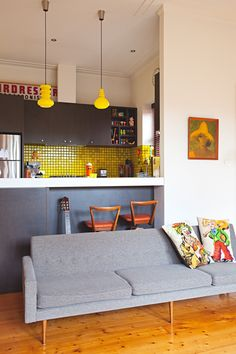 """Saskia & Tony's """"Sprinkled With Art & Toys"""" Style in Melbourne — House Tour (Apartment Therapy Main) Ikea Pictures, Dark Wood Cabinets, Melbourne House, Light And Space, Piece A Vivre, Under Cabinet Lighting, Trends, Wooden Shelves, Kitchen Storage"""