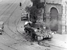 An M4 Sherman of Company C 741st Tank Battalion burns in the streets of Leipzig after being hit by a Panzerfaust. The entire crew perished. 18 April 1945. [3000x2440]