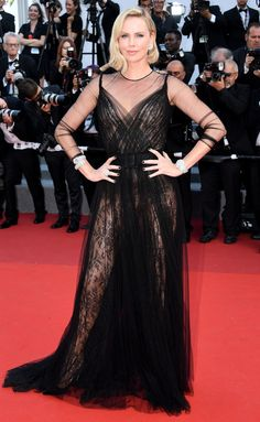 CHARLIZE THERON in Dior Haute Couture black tulle and lace dress accessorized withChoparddiamonds at the 70th anniversary celebration. - 2017 Cannes Film Festival
