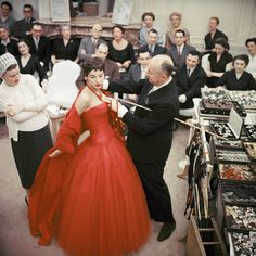 "Christian Dior with fashion model Victoire wearing the ""Zaire"" dress (Autumn Winter Haute Couture collection, H line) 1954 © 2013 Mark Shaw"