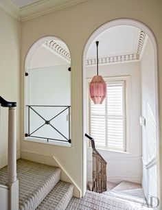 Gracing the stairway are a '20s Venini light from Bernd Goeckler Antiques and a Tai Ping carpet | archdigest.com