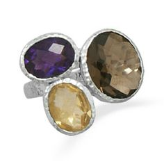 Sterling Silver Amethyst, Citrine and Quartz Ring Stunning Sterling Silver, Amethyst, Citrine and Quartz Ring 83210   Textured sterling silver ring with multisize oval stones. The faceted amethyst is approximately 8mm x 10.5mm, the citrine is 8.5mm x 10mm and the smoky quartz is 11mm x 13mm. The band is approximately 3mm. This ring is available in whole sizes 6-9. .925 Sterling Silver Jewelry Rings