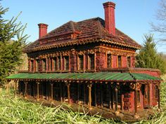 This train station was built as part of the Holiday Train show at the New York Botanical Gardens.  It was built completely of natural things such as seeds, pine cones, etc. by Applied Imagination under the direction of Paul Busse.  If your PBS station shows the special, Holiday Train Show (Narrated by  David Hartman)