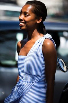 We are already on board with the off-the-shoulder top, but we definitely have been eyeing a few one-shoulder options thanks to street style inspiration like this one. These tops come in a variety of styles, but this one is a bit more polished due to the stripe which we often associate with a button-down shirt. A huge plus is that you can wear this must-have item with anything from denim to your favorite culottes.