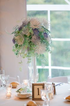 This Centerpiece is made up of hand cut pieces of recycled plastic water bottles that are pinned, then spray painted for color|A Dreamy Enchanted Garden Themed Fall Wedding|Photographer:  Nathan Desch Photography, LLC