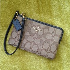 """✨Coach Logo Corner wristlet ✨ Crafted in jacquard fabric with a refined texture and hand-finished leather trim, this minimalist piece carries cards, cash and a phone in its secure, zip-top design. Applied hardware and a dogleash clip on the strap finish it with signature Coach style. Signature fabric  Two credit card pockets  Zip closure, fabric lining  Strap with clip to form a wrist strap or attach to the inside of a bag  6 1/4"""" (L) x 4"""" (H)  Fits an iPhone or Android✨Bundle and save✨ No…"""