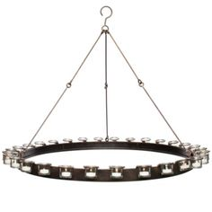 Ambrose Chandelier from Z Gallerie | Warm candlelight flickers against smooth metal, making this chandelier a halo of simple contrasts. A metal circular structure is outlined by detachable glass votives and supported by three durable chains.  For above my bathtub or a couple for the patio. Super reasonably priced.
