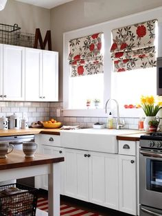 Update your kitchen keeping classic traditional elements: white painted cabinets, classic subway tile, a farmhouse sink. Keep colour confined to the things that are easy to change out (like the roman shades)to suit a BUYER'S personal style!