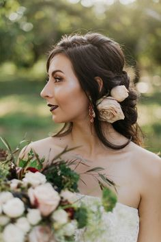 Romantic bridal hairstyle, curled hair, roses, dark purple lipstick, dramatic wedding beauty look // Loveridge Photography