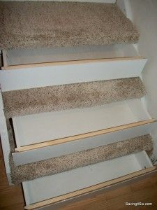 Secret compartment drawers under stairs.