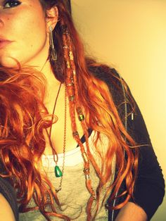 two dreads :) love just having a few dreads in my hair, nice balance between keeping my long hair en dreadlocks :)  #dreadlocks #redhead #beads #boho