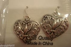 NEW!  SILVER COLOR FLEUR DE LIS EARRINGS WOULD  LOOK GREAT WITH YOUR OUTFIT.  REALLY CUTE!!