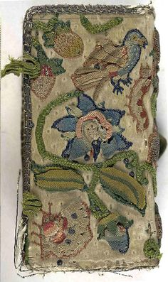Back cover of an embroidered satin book with bird motif and remnants of a pair of satin ties.