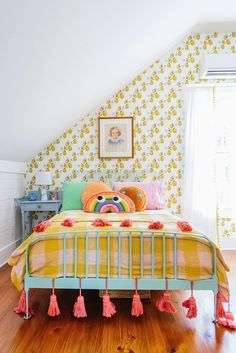beautiful kid's room filled with color and charm! eclectic girl bedroom design, boho girl bedroom design, vintage girl bedroom withn aqua bed and pompom tassel bedding, wallpaper in girl room, kid room in attic Deco Kids, Yellow Bedding, Bedding Sets, Bedroom Yellow, Nursery Bedding, Kids Decor, Home Decor, Decor Crafts, Little Girl Rooms