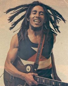 Bob Marley....whenever I feel down I listen to Jammin and it gives me a warm feeling inside and you feel like a shining sun..best drug ever