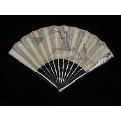 """Fan, possibly for mourning  ca. 1760  Origin: England  OL: 11 1/2"""" 11 1/2 x 19 1/4"""" open  Paper with cutwork and watercolor (grisaille), black lacquered wood, bone guards.  Museum Purchase  Acc. No. 1992-36  Colonial Williamsburg Collection"""
