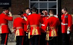 Raising a glass: Members of the Irish guards toast St Patrick's Day as they welcomed Prince William and The Duchess of Cambridge to their London barracks