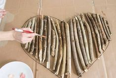 How to Make an Interesting Art Piece Using Tree Branches How to make a heart shaped wall art out of driftwood or tree branches and twigs. Includes tips on branch selection and shows how to tie branches together. Tree Branch Crafts, Tree Branch Decor, Twig Crafts, Driftwood Crafts, Nature Crafts, Craft Stick Crafts, Tree Branches, Painted Branches, Decoration Branches