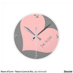 "Heart of Love - Time to Love in Pink and Gray Round Clock - Have you noticed that, in interior design, gray is utterly ""in""? This clock's timely gray plus a pink heart's splash of color will dress any wall. ""Time to Love"" can be changed or even deleted."