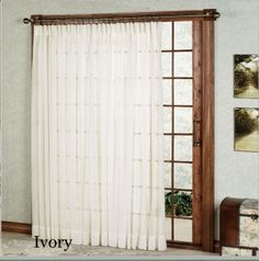 Have some privacy and enjoy natural light with the elegant Batiste Sheer Patio Door Curtain Panel.