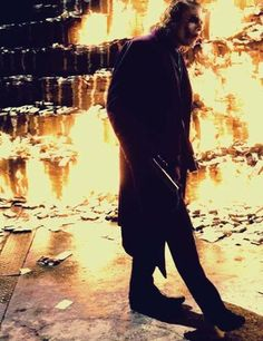 """I'm only burning my half.."" photo from The Dark Knight Heath Ledger as the Joker 