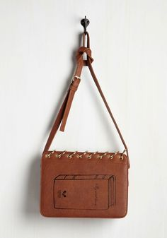 Made You Book! Bag. Strutting through the city with this chestnut brown bag over your shoulder, you take a minute to realize that everyone has their eyes on your statement-making accessory. #brown #modcloth