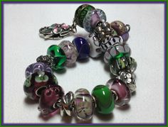 Morning Glory! This is one of the most beautiful bracelets I have seen and of course the photo is remarkable!  Thank you to a dear friend and collector on the forum! http://trollbeadsgalleryforum.ning.com/