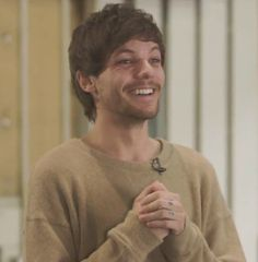 """Louis: I smile, """"So, I have a girlfriend now."""""""