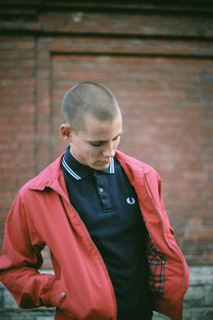 Fred Perry polo teed with a fitting James Dean esk red Harrington Jacket. not esque. he is grown and he visits here. Mode Skinhead, Skinhead Fashion, Skinhead Men, Fred Perry Shirt, Fred Perry Polo, Mode Punk, Skin Head, Football Casuals, Harrington Jacket