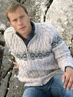 Made from 100% Merino Wool    This man's cable knit zip #cardigan is knit using traditional knitting patterns from Ireland.  Extra soft Merino Wool makes this zipper both warm and stylish.  The main feature of this zipper is the jacquard around the body and on the arms.