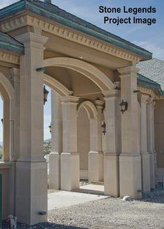Columns - Stone Legends - A walkway with cast stone including square columns, soffit surrounds and banding.
