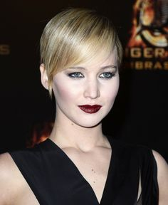 Transition into the colder months with this season's hottest lip shades: deep red, oxblood, and burgundy. Start with a bold lip stain and top with a medicated balm to protect your lips from the winter chill. (Beauty Queen: Jennifer Lawrence)