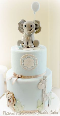 41 Best Baby Shower Cake Ideas to Inspire You. cute elephant giraffe and lion on baby shower cake with blue flower and ribbons around it. Baby Cakes, Cupcake Cakes, Cake Fondant, Sweets Cake, Fondant Figures, Mini Cakes, Cute Cakes, Pretty Cakes, Beautiful Cakes