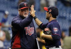 Apr 24, 2014; St. Petersburg, FL, USA; Minnesota Twins manager Ron Gardenhire (35) high fives left fielder Sam Fuld (1) after they beat the Tampa Bay Rays at Tropicana Field. Minnesota Twins defeated the Tampa Bay Rays 9-7. Mandatory Credit: Kim Klement-USA TODAY Sports