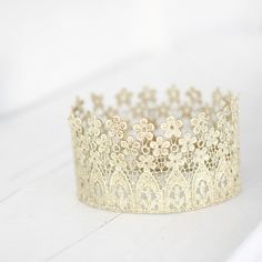 Crown ornament or large enough to wear. Lace and fabric stiffener.