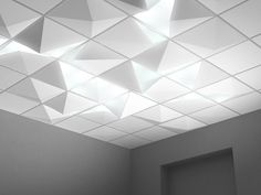 Really cool illuminated tile concept. I'd guess this is too custom/expensive to be realistic but maybe something similar could be accomplished with hue lights and clear tiles in some sections of drop ceiling.